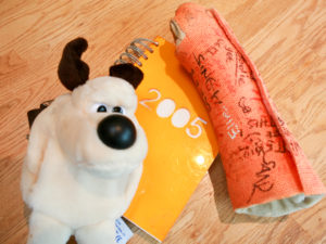 Plaster cast and diary and Gromit soft toy. family photos 3